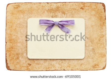 vintage card with lilac bow isolated on white background - stock photo