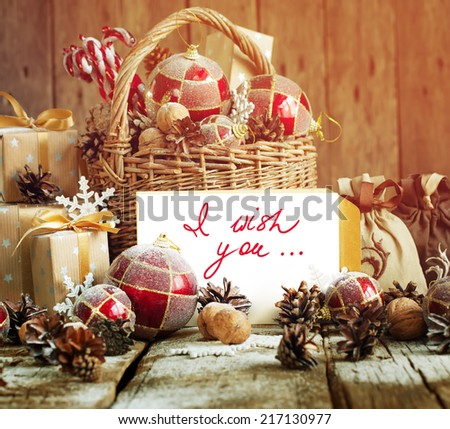 Vintage Card with Retro Fir Tree Toys. Gifts in Christmas Composition with Basket, Letter, Gifts. Toned effect and isolated text - stock photo