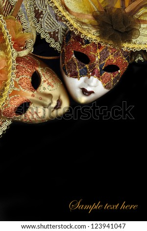 Vintage carnival masks on black background with copy-space - stock photo
