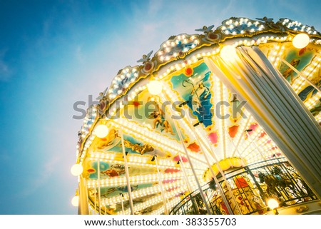 Vintage Carousel horse amusement attraction in the park - Vintage Filter - stock photo