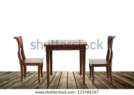 Vintage chairs and table on wooden board - stock photo