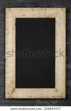 Vintage chalkboard blackboard in reclaimed old wooden frame gray brick wall with copy space - stock photo