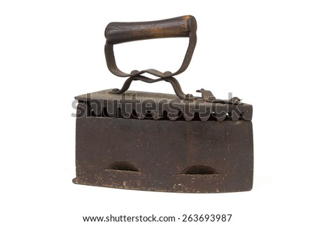 Vintage charcoral iron on white - stock photo