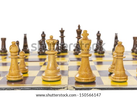 Vintage chess set with worn board close up.   - stock photo
