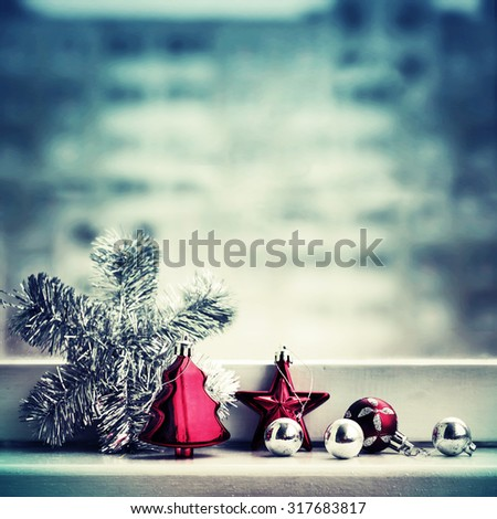 Vintage Christmas background with Christmas decoration against winter window/ selective focus - stock photo