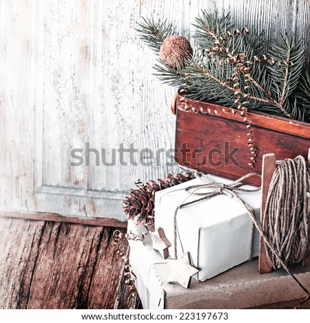 Vintage Christmas Card with Gifts, boxes, christmas decorations and christmas pine cones - stock photo