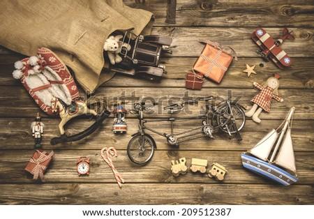 Vintage christmas decoration: old nostalgic children toys on wooden background. - stock photo