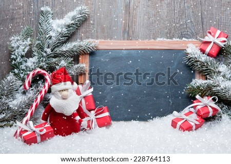 Vintage Christmas decoration with Santa Claus and chalkboard for message - stock photo