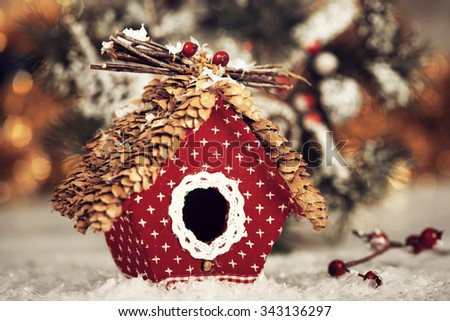 Vintage Christmas greeting card with small birdhouse - stock photo