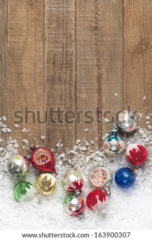 Vintage Christmas Ornaments in a Snowdrift on Wood Background with Room or Space for Copy, Text, Words, Vertical  - stock photo