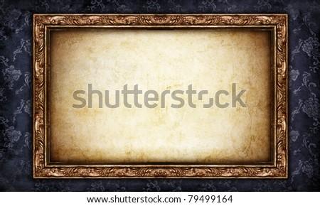 vintage classical frame on shabby black wallpaper - stock photo