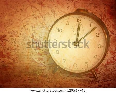 vintage clock against antique  background - stock photo
