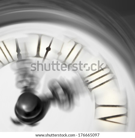 Vintage clock blurred - conceptual image of time running or passing away  - stock photo