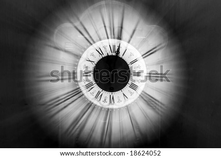 Vintage clock blurred in - stock photo