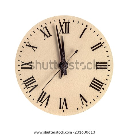 Vintage clock face showing two minutes to twelve isolated over white - stock photo