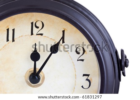 Vintage clock showing five past twelve against a white background - stock photo