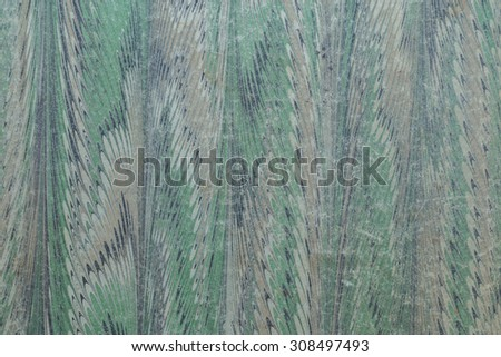 Vintage cloth fragment from a tropical shirt in tones of green, blue, black, white, and gray/grey tones. - stock photo