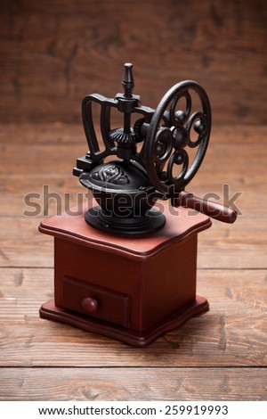 Vintage coffee mill on rustic old wooden table - stock photo