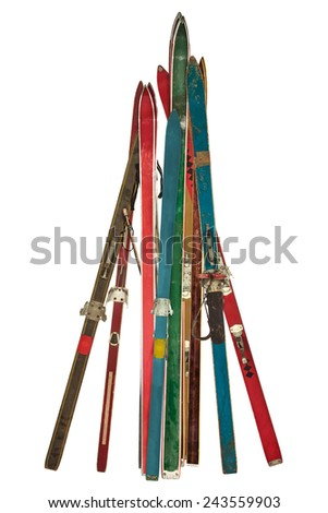 Vintage collection of different used skis isolated on a white background - stock photo