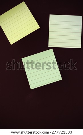 vintage color style of note papers or notepad paper posting on black background - stock photo