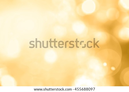 Vintage color tone blurred nature background of a view looking up through foliage of tree against sky facing sun flare and bokeh: Blurry natural greenery wood forest view in yellow gold orange tone - stock photo