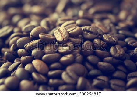 vintage color tone, coffee beans on the old wooden background, soft focus - stock photo