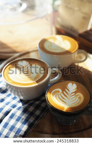 vintage color tone of  cup of coffee with red heart on the table coffee shop  - stock photo