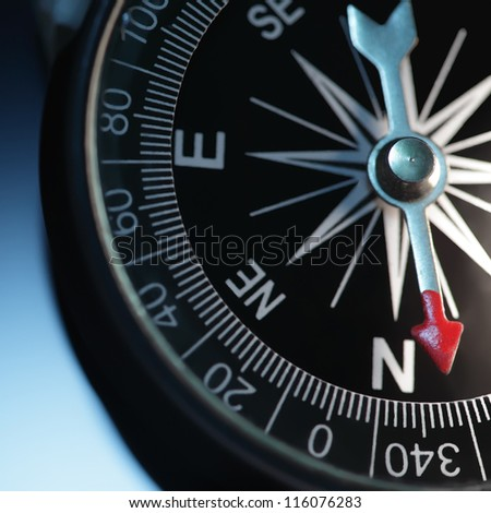 Vintage compass in blue background - stock photo