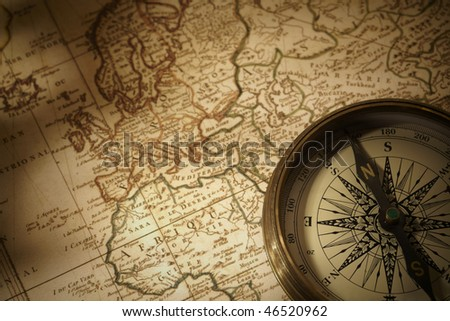 vintage compass on a map - stock photo