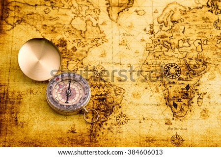Vintage compass on world map. - stock photo
