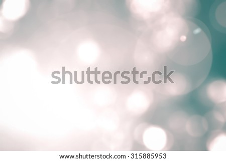 Vintage cool cyan pink green color tone blurred nature background of a view looking up through the foliage of a tree against the sky facing sun flare and bokeh: Blurred natural greenery bokeh  - stock photo