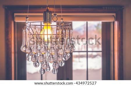 Vintage crystal chandelier ( Filtered image processed vintage effect. ) - stock photo