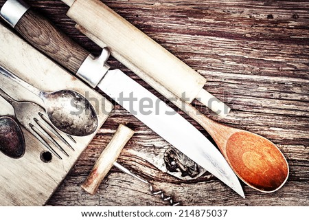 Vintage cutlery on rustic wooden background/ Vintage Kitchen Utensils for cooking - stock photo