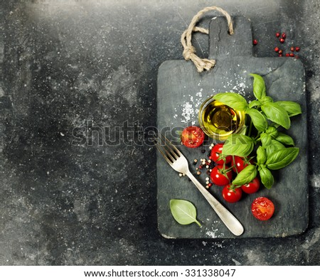 vintage cutting board and fresh ingredients - Cooking, Italian food, Healthy Eating or Vegetarian concept - stock photo