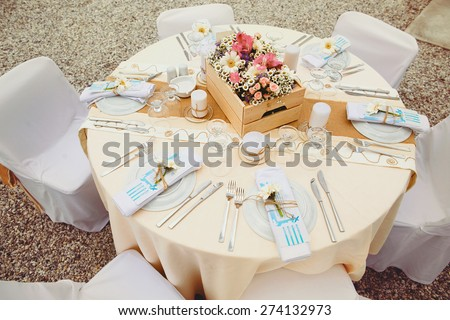 vintage decor wedding ceremony on the bank on the background of the sea near the island of Milos Greece - stock photo