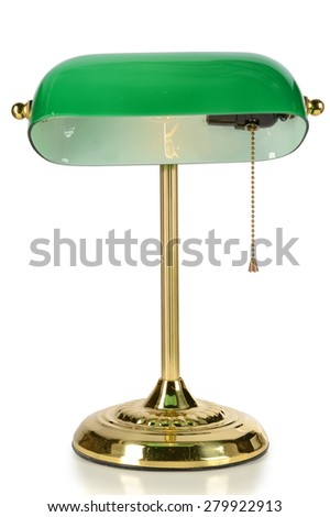 Vintage desk lamp with green glass shade isolated over white background - With clipping path - stock photo