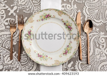 vintage dinner place setting for formal dinner - stock photo