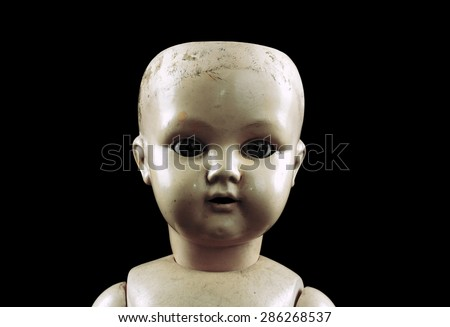 Vintage doll face isolated on black with clipping path  - stock photo