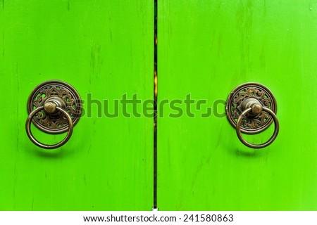 Vintage door full of colors in Thailand  - stock photo