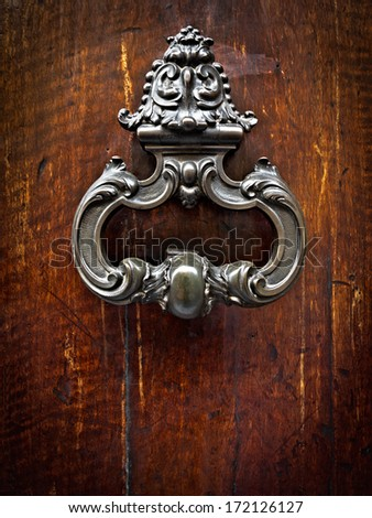 Vintage doorknob. Medieval door. - stock photo