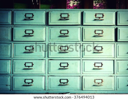 Vintage Drawer with Cross process colour style - stock photo