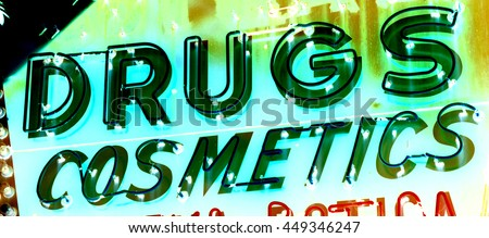 vintage drugs and cosmetics neon sign, negative color - stock photo