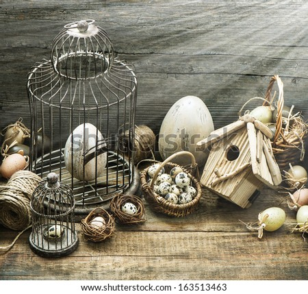vintage easter decoration with eggs, birdhouse and birdcage. nostalgic style picture with sun beams effect - stock photo