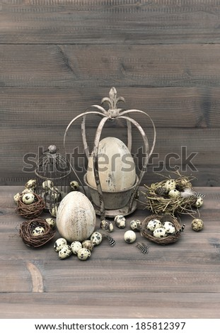 vintage easter decoration with eggs, nest and birdcage. nostalgic still life. wooden background - stock photo