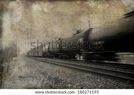 Vintage effect applied to fast moving freight train. - stock photo