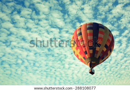vintage effect of Hot air balloon in the sky - stock photo