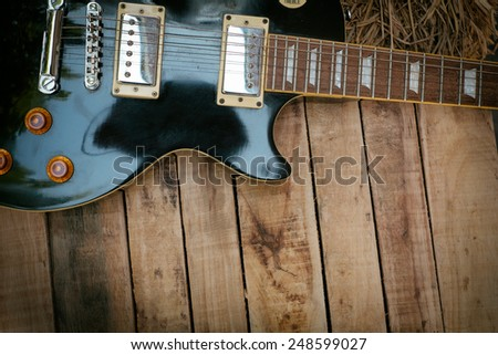 Vintage Electric Guitar on wood - stock photo