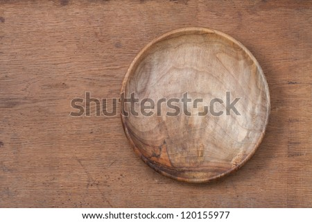Vintage empty wooden plate on oak table wood texture background - stock photo
