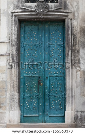vintage Entrance door decorated with wrought iron - stock photo