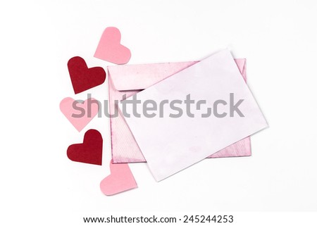 vintage envelope with paper page and valentines hearts - stock photo